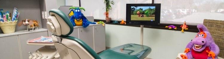 Children's dentist chair with stuffed animals